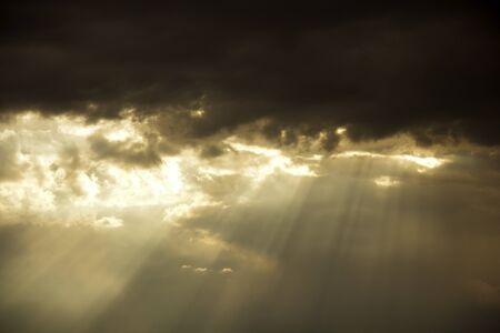 Sunbeams Breaking Through Storm Clouds