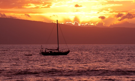 Moored Boat at Sunset photo