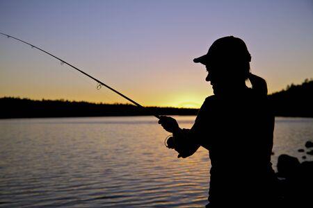 resting rod fishing: Sunset Fishing Close up