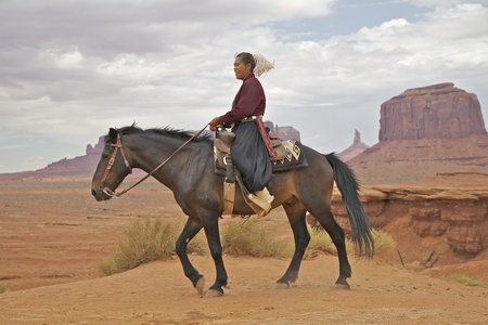 tribal park: Navajo Woman on Horse in Monument Valley Stock Photo