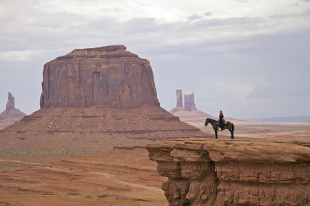 Horseback in Monument Valley Stock Photo - 14431124