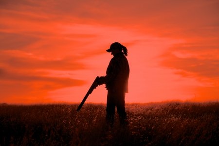 hunting: Female Upland Game Hunter in Sunset