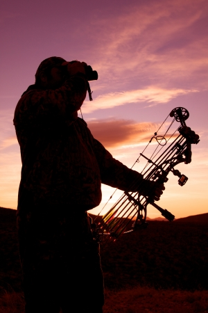 Bowhunter Glassing at Sunrise