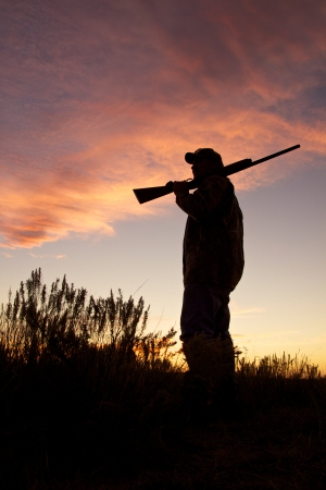 hunter man: Bird Hunter Silhouetted at Sunrise Stock Photo
