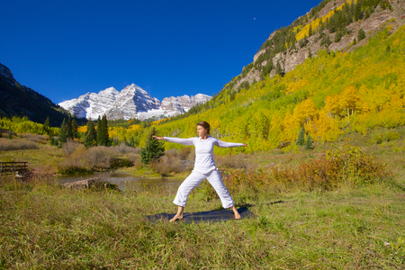 Yoga at Maroon bells in Fall photo