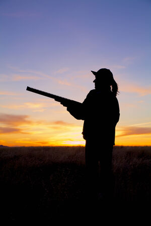 Mujer Hunter en Sunrise photo