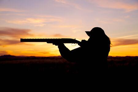 Woman Hunter Shooting at Sunrise photo