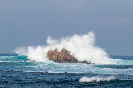 waves crashing: Waves Crashing Rocks Stock Photo