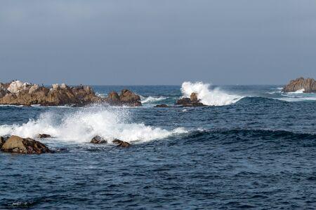 waves crashing: Waves Crashing Ashore on Rocks