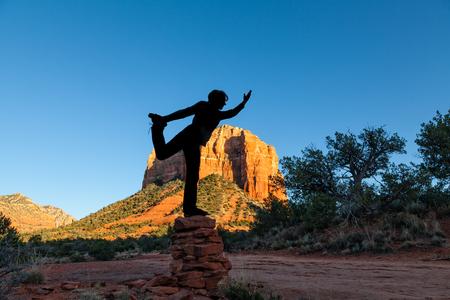 sedona: Silhouetted in Yoga Pose at Sedona Stock Photo
