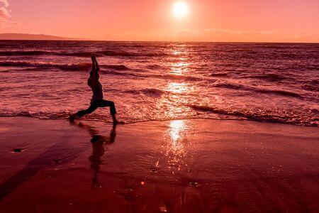 spiritual energy: Woman Silhouetted Practicing Yoga on Maui
