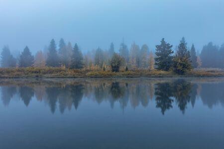 Foggy Sunrise Reflection in Fall Stock Photo