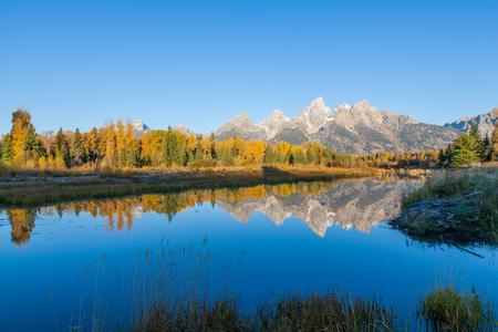 Teton Sunrise Reflection in Fall Stock Photo