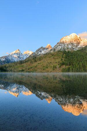 Teton Sunrise Reflection in String Lake Stock Photo