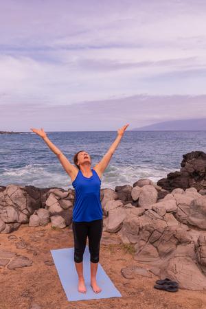 Woman Practicing Yoga on the Maui Coast