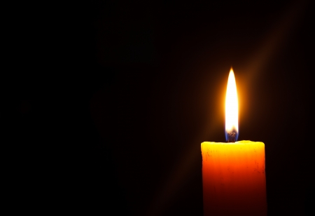 Closeup of a candle with black background photo