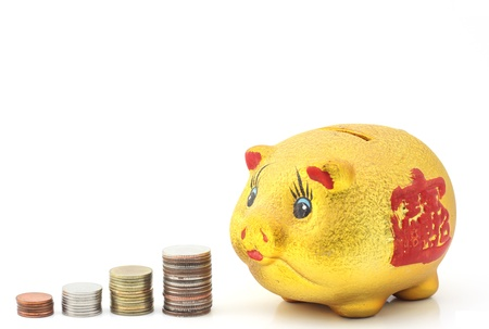 Piggy Bank with coins stack Stock Photo