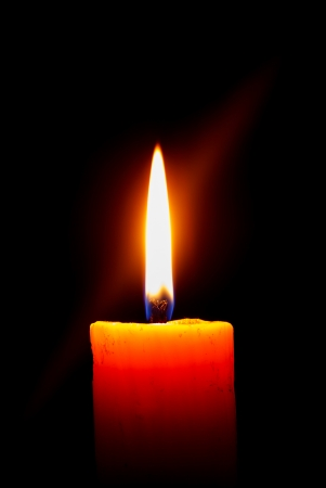 in loving memory: candle light in the darkness Stock Photo