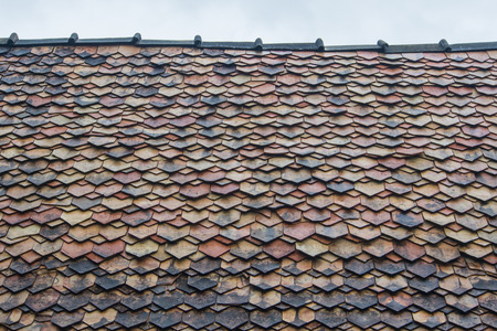 rooftiles: Old roof tiles is lichen and roof in should be repair. Stock Photo