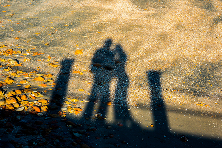 ambiguous: Man and Woman with reflection body on the beach.