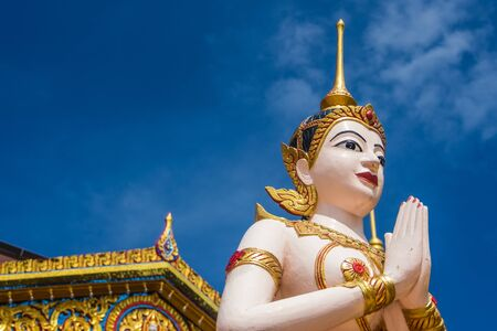humanism: Buddha statue in front of temple usefor input text in frame picture.