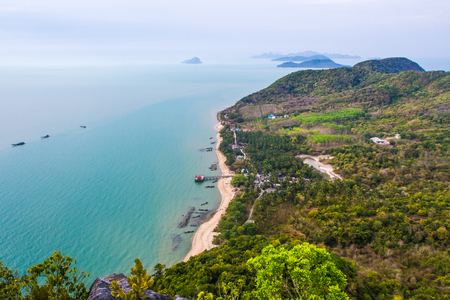 The Old marina or the pier or the port on the beach of fisherman living. Top view on the mountain Traditional fishing village is secluded and clear turquoise sea waters, small island, Thailand.