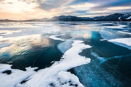frozen lake: Fantastic winter landscape with frozen lake. Beautiful sunset with dramatic sky
