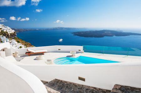 honeymoon suite: White architecture on Santorini island, Greece. Beautiful landscape with sea view. Editorial