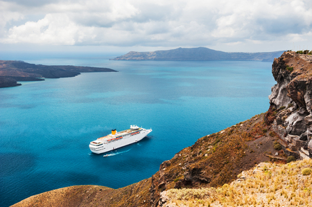 cruise liner: Beautiful landscape with sea view. Cruise liner at the sea near the islands. Santorini island, Greece. Stock Photo