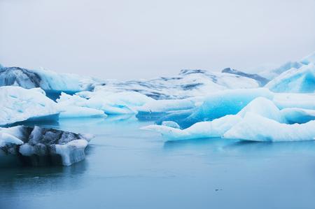 blue lagoon: Beautiful blue icebergs in Jokulsarlon glacial lagoon. Vatnajokull glacier, south of Iceland