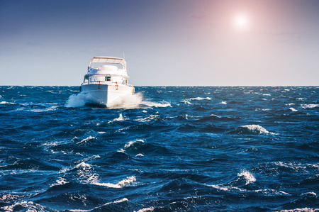 White yacht in the Red sea at sunset. Beautiful summer seascape
