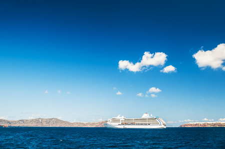 greek islands: Big cruise liners near the Greek Islands. Santorini island, Greece. Sea snd sky. Summer landscape