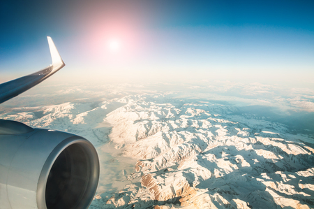 aeroplane: Mountain view from an airplane window. Travel holiday background