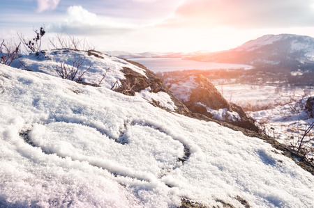 winter sky: Heart on the snow. Winter landscape in the mountain at sunset