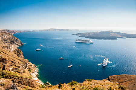 greek island: Cruise liners near the Greek Islands. Beautiful landscape with sea view. Santorini island, Greece Stock Photo