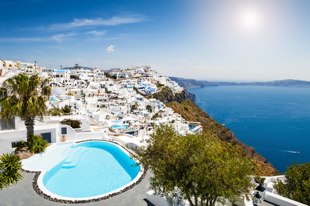 White architecture on Santorini island, Greece. Swimming pool in luxury hotel. Beautiful view on the sea