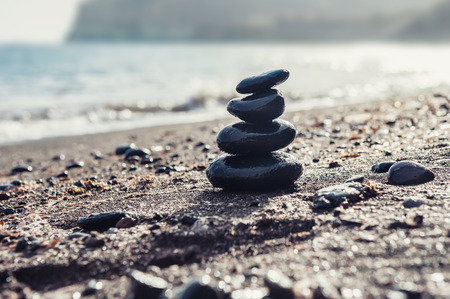 zen: Stones pyramid on the beach. Selective focus. Zen and harmony. Stock Photo