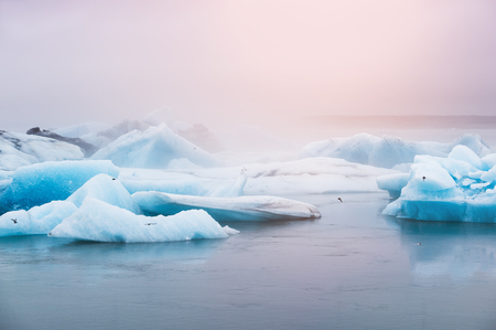 Beautiful blue icebergs in Jokulsarlon glacial lagoon at sunset. Vatnajokull glacier, south of Iceland