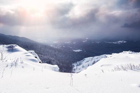 snow covered mountains: Snow covered mountains at sunset. Beautiful winter landscape. Winter forest.