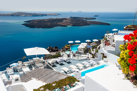 Luxury hotel with sea view. White architecture on Santorini island, Greece. Beautiful view on the sea