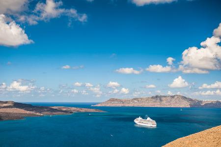 greek islands: Cruise liners near the Greek Islands. Bright turquoise sea and blue sky. Santorini island, Greece Stock Photo