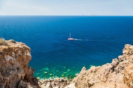 seacoast: Beautiful view of the seacoast. Bright turquoise sea and blue sky. Santorini island, Greece.