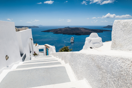 country house: Stairs leading down to the sea. White architecture on Santorini island, Greece. Beautiful view on the sea. Concept of a perfect holiday