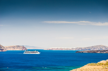 cruise liner: Cruise liner near the Greek Islands. Bright turquoise sea and blue sky. Santorini island, Greece