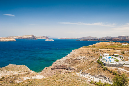 greek islands: Cruise liner near the Greek Islands. Bright turquoise sea and blue sky. Santorini island, Greece