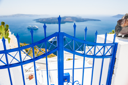 wicket door: White architecture on Santorini island, Greece. Beautiful view on the sea