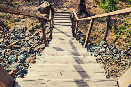 Stock Photo   Wooden Stairs On The Hill Leading Down. Summer Landscape