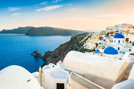 Beautiful view of Oia town at sunset. White architecture on Santorini island, Greece. Stock Photo