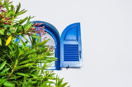 Blue window. National Greek architecture, Santorini island, Greece.
