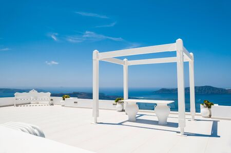 venue: Wedding venue on the roof with sea view. Santorini island, Greece. Stock Photo
